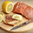 Appetizing sandwich with salmon and lemon — Stock Photo #21434929