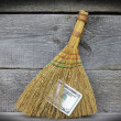 Image of broom with dollars, close-up — Stock Photo
