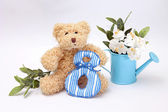 Composition on March 8 - teddy bear with flowers — Stock Photo