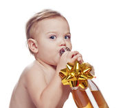 Baby boy with bottle of fizz — Stock Photo