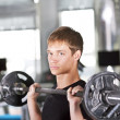 Men with barbell — Stock Photo