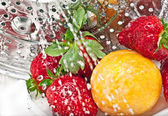 Strawberry, plum and water — Stock Photo