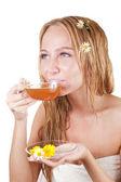 Beauty girl is drinking tea — Stock Photo