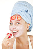 Beautyful girl with a face mask — Stock Photo
