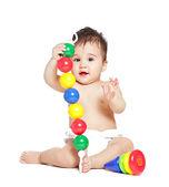 Niño asiático con juguete sobre un fondo blanco — Foto de Stock