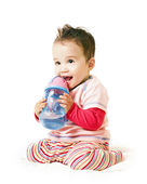 Asian laughing baby boy with spout cup — Stock Photo