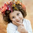 Brunette girl in a autumn crown — Stock Photo