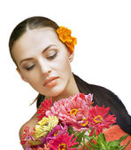 Portrait of brunette spa woman with flower — Stock Photo