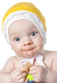Beautiful baby boy with nibbler — Stock Photo