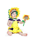Caucasian baby boy in a sunflower fancy dress — Stock Photo