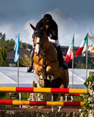Man and horse jumping — Foto Stock