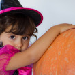 Little witch with pumpkin — Stock Photo