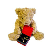 Teddy bear with golden heart and rings — Stock Photo