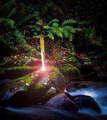 Sword and stone — Stock Photo
