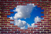 Brick wall and blue sky — Stock Photo