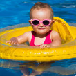 Baby swimming in a pool — Stock Photo #29299555