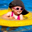 Baby swimming in a pool — Stock Photo