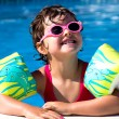 Little girl in a pool — Stock Photo