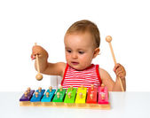 Baby playing xylophone — Stock Photo