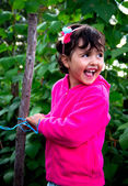 Little girl in orchard — Stock Photo