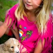 Little girl with puppy — Stock Photo