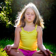 Little girl meditating — Stock Photo