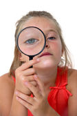 Little girl with magnifier — Stock Photo