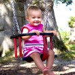 Stock Photo: Baby on swing