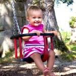 Baby on swing — Stock Photo #32192091