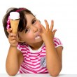 Little girl eating ice cream — Stock fotografie