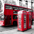 Stock Photo: Red phone booth and red bus