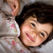 Little girl in bed — Stock Photo