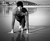 Athlete on beach — Stok fotoğraf