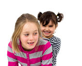 Two little girls combing — Stock Photo