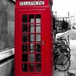 Red phone booth — Stock Photo #39377817