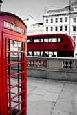 Red phone booth and red bus — Stock Photo