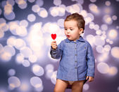 Baby with lollipop — Stock Photo