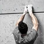 Young man climbing — Stock Photo #49541245