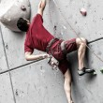 Young man climbing — Stock Photo #49541247