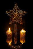 Christmas star on black — Stock Photo