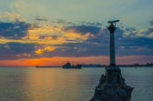 Monument to the sunk ships in Sevastopol at sunset. — Stock Photo