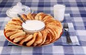 Fritters with sour cream — Stock Photo