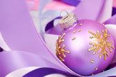 Christmas ball on ribbons — Stock Photo