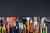 Work tools on black background. — Stock Photo