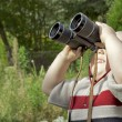 Boy with Binoculars in the Garden - Stock Photo