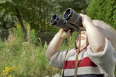Boy with Binoculars in the Garden — Stock Photo