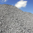 Gray Gravel Hill - Stock Photo