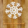 White paper christmas snowflake on a wood.  + EPS8 — Stock Vector