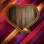 Colorful wooden heart on wood. EPS 10 — Cтоковый вектор