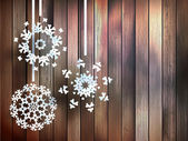 Snowflakes hanging over wooden. EPS 10 — Stock Vector